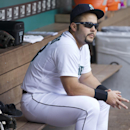 Seattle Mariners' Jesus Montero sits in the dugout before a baseball game against the San Diego Padres in Seattle, Tuesday, June 17, 2014 The Associated Press