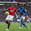Manchester United's Antonio Valencia, left, fights for the ball against Leicester's Jeffrey Schlupp during the English Premier League soccer match between Manchester United and Leicester at Old Trafford Stadium, Manchester, England, Saturday Jan. 31, 2015