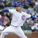 Chicago Cubs starting pitcher Travis Wood pitches against the Pittsburgh Pirates during the second inning of a baseball game, Thursday, April 10, 2014 in Chicago The Associated Press