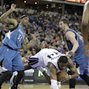 Sacramento Kings forward Jason Thompson, center, dives for the ball between Minnesota Timberwolves' Dante Cunningham, left,and Kevin Love during the third quarter of an NBA basketball game in Sacramento, Calif., Saturday, March 1, 2014. The Timberwolve