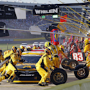 Crew members perform a pit stop on driver Matt Kenseth's car during the NASCAR Sprint Cup series auto race at Charlotte Motor Speedway in Concord, N.C., Sunday, May 24, 2015. (AP Photo/Terry Renna)