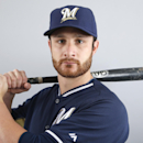 This Feb. 23, 2014 file photo shows Jonathan Lucroy of the Milwaukee Brewers baseball team posed at the teams training facility in Phoenix, Ariz. The Brewers love the core that they've built up the middle. Behind the plate, it starts with Lucroy, the fi
