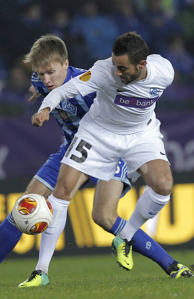 Belgium's KRC Genk player Fabien Camus, right, challenges Ukraine's Dynamo Kiev Sergii Sydorchuk, during the Europa League Group G soccer match, in Genk, eastern Belgium, Thursday, Nov. 28, 2013