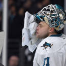 San Jose Sharks goalie Antti Niemi, of Finland, wipes his face after giving up a goal to Los Angeles Kings center Anze Kopitar, of Slovenia, during the second period of an NHL hockey game, Saturday, Dec. 27, 2014, in Los Angeles. (AP Photo/Mark J. Terrill)