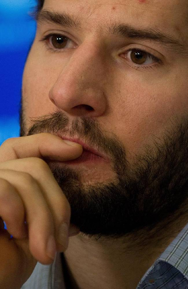 In this April 14, 2014 file photo, Vancouver Canucks' Ryan Kesler listens during an end of season news conference in Vancouver, British Columbia. The Anaheim Ducks have acquired Kesler from the Canucks in a trade for center Nick Bonino, defenseman Luca Sbisa and the 24th overall pick in Friday's June 24, 2014 draft