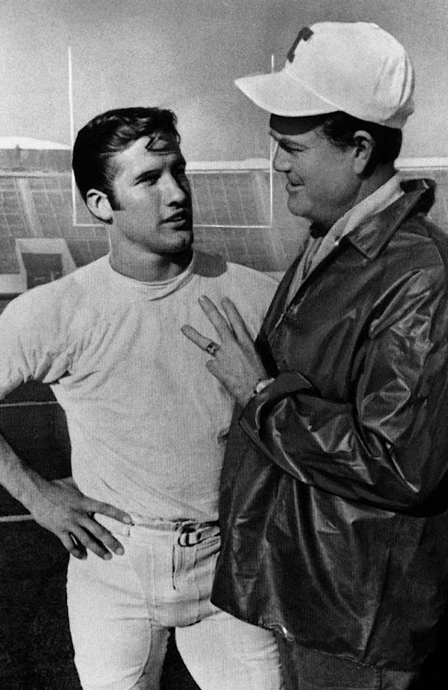 In this Nov. 25, 1969 file photo, Darrell Royal, right, head coach of No. 1 ranked Texas, talks with his quarterback, James Street, in Austin, Texas. Street, who took over the Longhorns' wishbone offense and led them to the 1969 national championship, has died. He was 65. Serena Fitchard of the James Street Group said Street died early Monday, Sept. 30, 2013