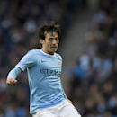 Manchester City's David Silva takes the ball downfield during his team's English Premier League soccer match against Stoke at the Etihad Stadium, Manchester, England, Saturday, Feb. 22, 2014