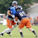Chicago Bears tight end Zach Miller works with tight end Matthew Mulligan (85) during the team's NFL football training camp on Saturday, July 26, 2014, in Bourbonnais, Ill The Associated Press
