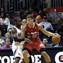 Los Angeles Clippers power forward Blake Griffin (32) works against Atlanta Hawks power forward Paul Millsap (4) in the first half of an NBA basketball game Wednesday, Dec. 4, 2013, in Atlanta The Associated Press