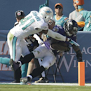 Baltimore Ravens wide receiver Steve Smith (89) scores a touchdown as Miami Dolphins defensive back R.J. Stanford (41) defends during the first half of an NFL football game, Sunday, Dec. 7, 2014, in Miami Gardens, Fla The Associated Press