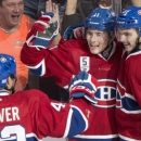 Montreal Canadiens' Brendan Gallagher (11) celebrates with teammates Alex Galchenyuk (27) and Mike Weaver after scoring against the Minnesota Wild during the second period of an NHL hockey game Saturday, Nov. 8, 2014, in Montreal The Associated Press