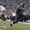 Seattle Seahawks quarterback Russell Wilson, right, scores ahead of Chicago Bears' Lance Briggs in the first half of a preseason NFL football game, Friday, Aug. 22, 2014, in Seattle The Associated Press
