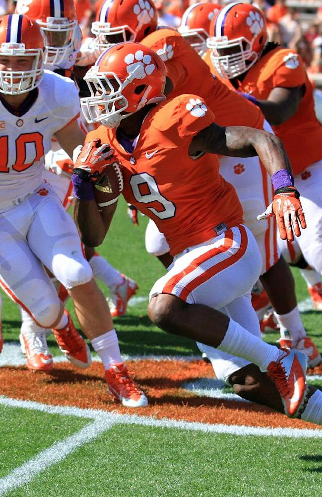 Clemson running back Wayne Gallman, right, turns the corner with linebacker Ben Boulware (10) in pursuit during an NCAA college football spring game at Memorial Stadium in Clemson, S.C., Saturday, April 12, 2014