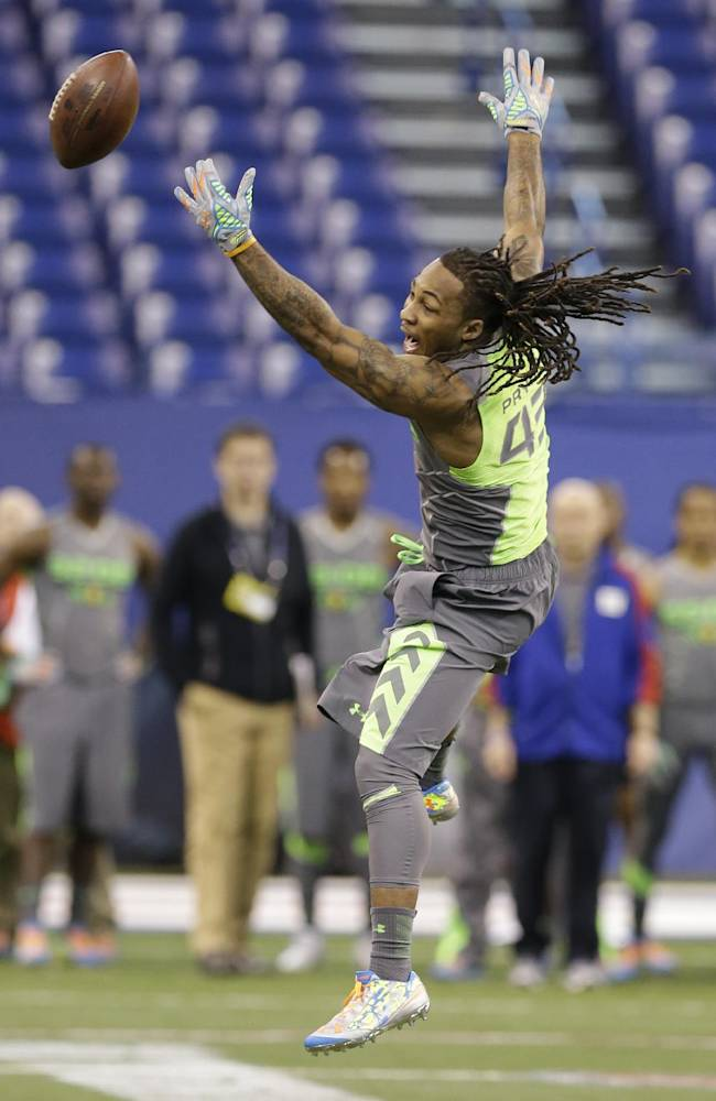 Louisville defensive back Calvin Pryor misses a catch during a drill at the NFL football scouting combine in Indianapolis, Tuesday, Feb. 25, 2014
