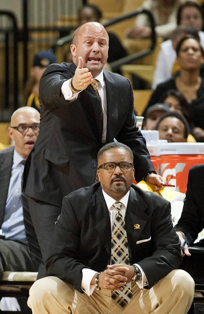 Missouri head coach Frank Haith, bottom, watches his team play as assistant coach Mark Phelps argues a call during the second half of an NCAA college basketball exhibition game against Central Missouri, Friday, Nov. 1, 2013, in Columbia, Mo. Missouri won 92-79