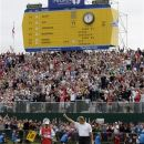 Winner of the British Open Golf Championship Ernie Els of South Africa reacts on the 18th green after his final round, at Royal Lytham & St Annes golf club, Lytham St Annes, England Sunday, July  22, 2012. (AP Photo/Peter Morrison)