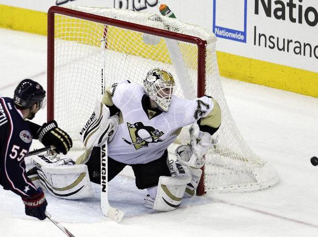 Pittsburgh Penguins' Jeff Zatkoff, right, makes a save against Columbus Blue Jackets' Mark Letestu during the third period of an NHL hockey game Sunday, Dec. 29, 2013, in Columbus, Ohio. The Penguins won 5-3