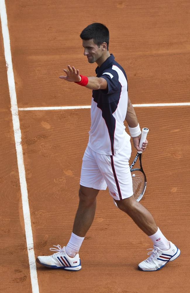Novak Djokovic of Serbia acknowledges applause after defeating Albert Montanes of Spain in 6-1 6-0, during their match in the Monte Carlo Tennis Masters tournament in Monaco, Tuesday, April 15, 2014