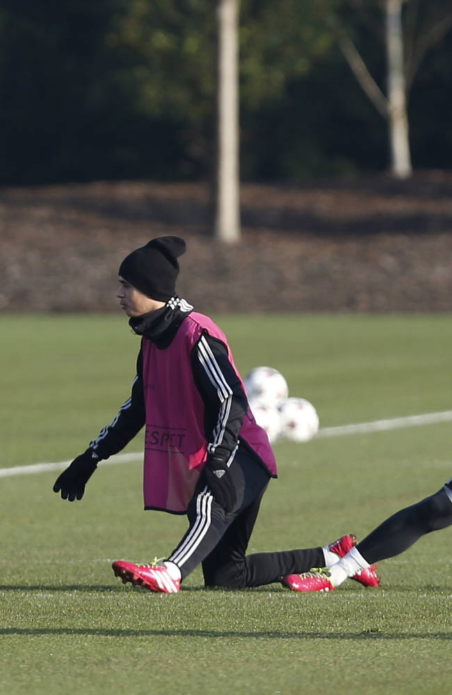 Chelsea's Juan Mata, left, Oscar, center, and Fernando Torres warm up during a training session at Cobham training ground in Cobham, England, Tuesday, Dec. 10, 2013. Chelsea will play Steaua Bucharest in the Champions League group E soccer match at Stamford Bridge stadium on Wednesday, Dec. 11