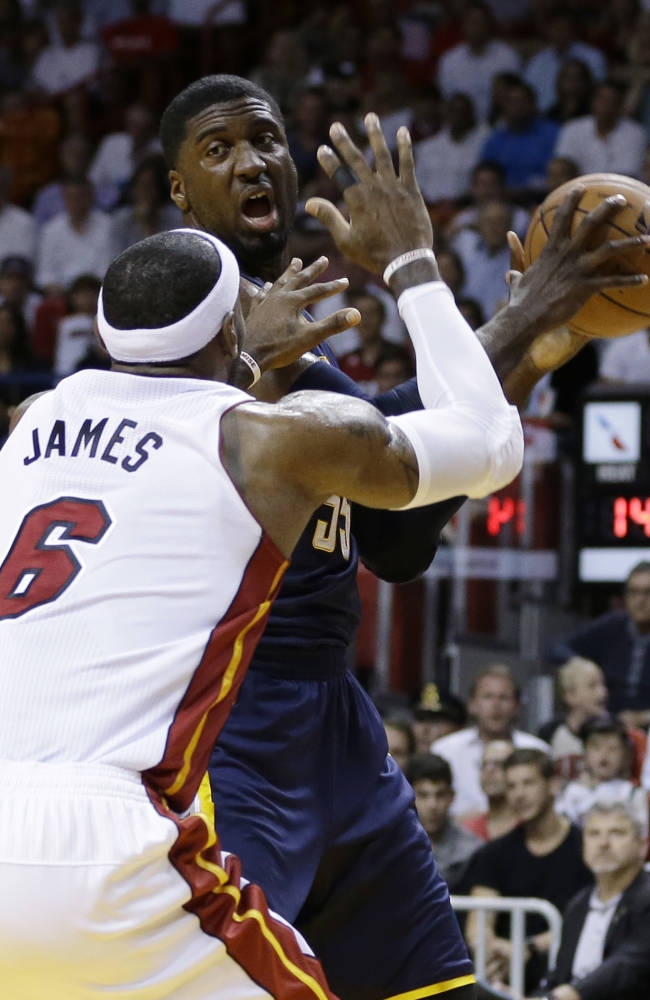 Heat back atop East, beat Pacers 98-86