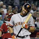 San Francisco Giants' Angel Pagan grimaces after being called out on strikes against the Arizona Diamondbacks during the ninth inning of a baseball game, Wednesday, April 2, 2014, in Phoenix. The Giants defeated the Diamondbacks 2-0 The Associated Press