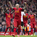 Liverpool's Martin Skrtel, centre, celebrates with teammates as his team beat Manchester City 3-2 during their English Premier League soccer match at Anfield Stadium, Liverpool, England, Sunday April 13, 2014