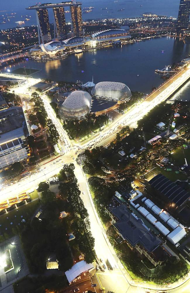 A bird-eye view of the Singapore F1 Grand Prix's Marina Bay City Circuit, shot with a fish-eye lens, is seen at dusk from Swissotel The Stamford in Singapore, Tuesday, Sept. 17, 2013. The race is slated for September 21-23