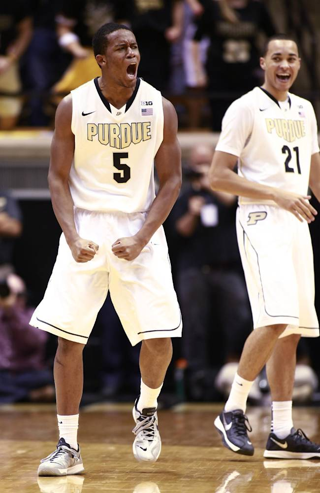 Purdue forward Basil Smotherman (5) reacts after a play alongside Purdue guard Kendall Stephens in the second half of an NCAA basketball game versus Rider in West Lafayette, Ind., Sunday, Nov. 17, 2013. Purdue won 81-77