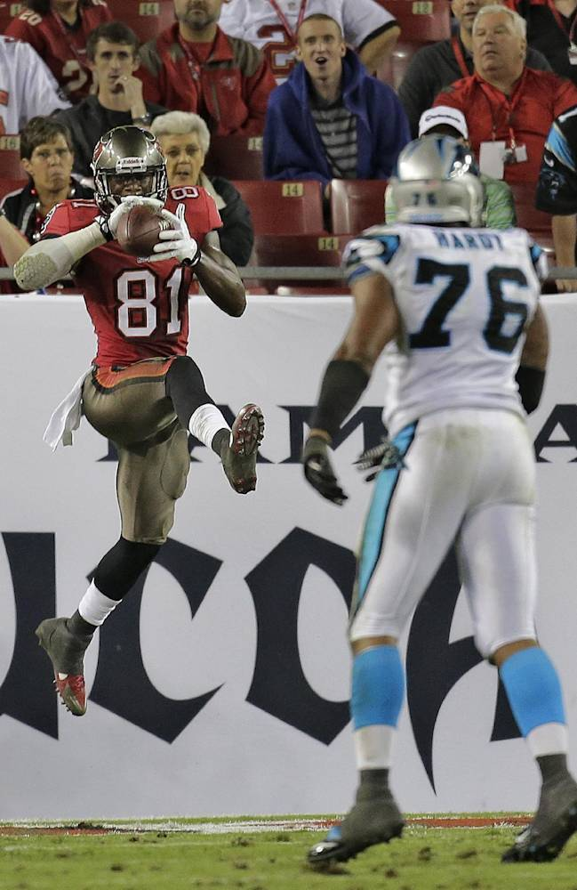 Tampa Bay Buccaneers tight end Timothy Wright (81) catches a 10-yard touchdown pass in front of Carolina Panthers defensive end Greg Hardy (76) during the fourth quarter of an NFL football game Thursday, Oct. 24, 2013, in Tampa, Fla