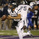 Nevada quarterback Cody Fajardo rolls out of the pocket for a short gain against Air Force in the first quarter of an NCAA college football game in Air Force Academy, Colo., on Friday, Oct. 26, 2012. (AP Photo/David Zalubowski)