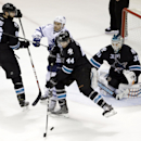 Toronto Maple Leafs' David Clarkson, center in white, works against San Jose Sharks' Marc-Edouard Vlasic (44), Brent Burns (88) and goalie Antti Niemi during the second period of an NHL hockey game Thursday, Jan. 15, 2015, in San Jose, Calif The Associate