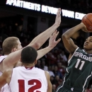 Michigan State's Keith Appling shoots against Wisconsin's Evan Anderson, left, and Traevon Jackson (12) during the first half of an NCAA college basketball game Tuesday, Jan. 22, 2013, in Madison, Wis. Appling had a game-high 19 points in Michigan State's 49-47 win. (AP Photo/Andy Manis)