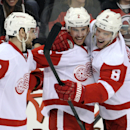 Detroit Red Wings' Brendan Smith, center, celebrates his goal with Justin Abdelkader, right, and Brian Lashoff during the second period of an NHL hockey game against the New Jersey Devils Tuesday, March 4, 2014, in Newark, N.J The Associated Press