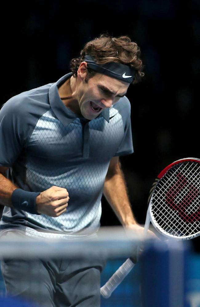 Roger Federer of Switzerland celebrates after he wins a point against Juan Martin Del Potro of Argentina during their ATP World Tour Finals tennis match at the O2 Arena in London, Saturday, Nov. 9, 2013