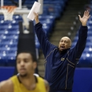 North Carolina A&T head coach Cy Alexander directs his players during practice ahead of an NCAA college basketball tournament game, Monday, March 18, 2013, in Dayton, Ohio. North Carolina A&T plays Liberty Tuesday evening in a first-round game. (AP Photo/Al Behrman)