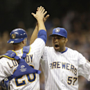Milwaukee Brewers' Francisco Rodriguez (57) reacts with catcher Jonathan Lucroy after getting the final out on the Pittsburgh Pirates in the ninth inning of a baseball game Saturday, April 12, 2014, in Milwaukee. The Brewers won 3-2 The Associated Press