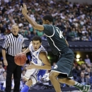 Duke guard Seth Curry (30) drives around Michigan State guard Gary Harris (14) during the second half of a regional semifinal in the NCAA college basketball tournament, Friday, March 29, 2013, in Indianapolis. (AP Photo/Michael Conroy)