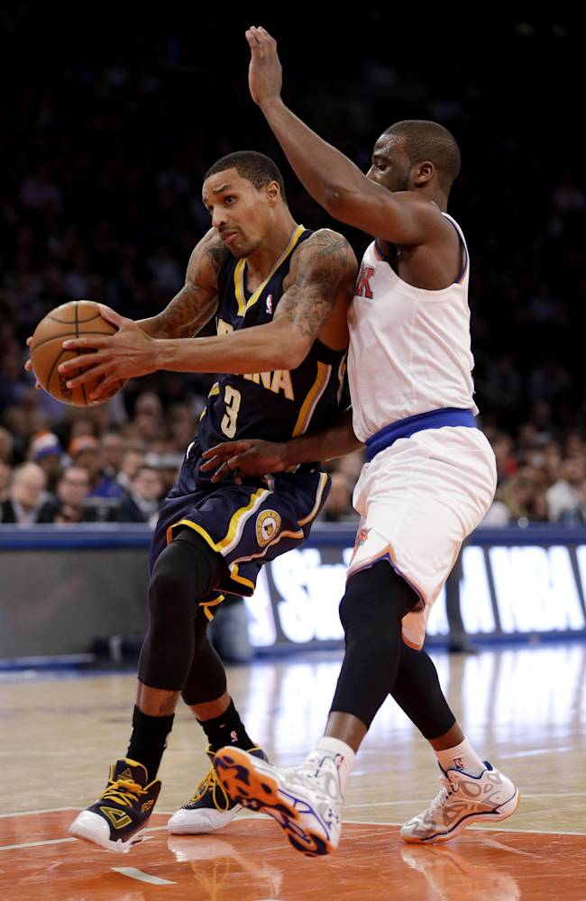 New York Knicks's Raymond Felton, right, defends Indiana Pacers' George Hill during the first half of an NBA basketball game at Madison Square Garden, Wednesday, March 19, 2014, in New York