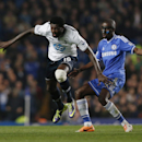 Tottenham Hotspur's Emmanuel Adebayor, left, is tackled by Chelsea's Ramires during their English Premier League soccer match at Stamford Bridge, London, Saturday, March 8, 2014