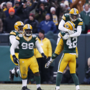 Green Bay Packers free safety Ha Ha Clinton-Dix (21) and Green Bay Packers strong safety Morgan Burnett (42) celebrate after officials reversed a catch by Dallas Cowboys wide receiver Dez Bryant (88) during the second half of an NFL divisional playoff foo