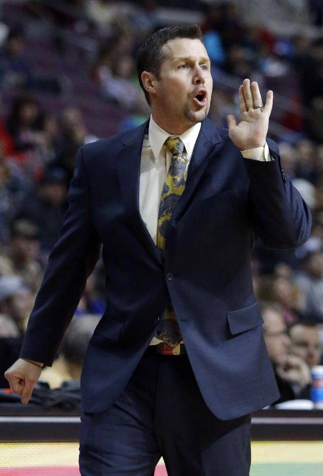 Memphis Grizzlies coach David Joerger shouts directions to his team during the second half of their 112-84 win over the Detroit Pistons in an NBA basketball game on Sunday, Jan. 5, 2014, in Auburn Hills, Mich