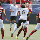 Manchester United's Juan Mata (8) collides with AS Roma's Leandro Paredes during an exhibition soccer match at Mile High Stadium in Denver, Saturday, July 26, 2014. Manchester United won 3-2
