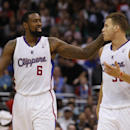 Los Angeles Clippers center DeAndre Jordan, left, smiles at teammate forward Blake Griffin, right, after Griffin dunked the ball against the Sacramento Kings during the second half of an NBA basketball game in Los Angeles, Saturday, April 12, 2014. The Cl