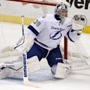 Tampa Bay Lightning goalie Ben Bishop (30) gloves a shot by the Pittsburgh Penguins during the first period of an NHL hockey game in Pittsburgh Monday, Dec. 15, 2014. Bishop suffered a lower body injury and did not return for the second period. The Pengui