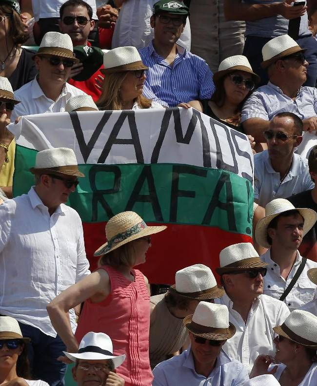 Supporters of Spain's Rafael Nadal hold a banner reading