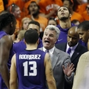 Kansas State head coach Bruce Weber, center, talks to his team during a time out in the second half of an NCAA college basketball game against Oklahoma State in Stillwater, Okla., Saturday, March 9, 2013. Oklahoma State won 76-70. (AP Photo/Sue Ogrocki)