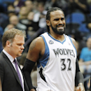 Minnesota Timberwolves center Ronny Turiaf injured his knee and is taken off the court by Timberwolves trainer Gregg Farnam in the fourth quarter of an NBA basketball game, Wednesday, Feb. 19, 2014 in Minneapolis. The Timberwolves won 104-91 The Associate