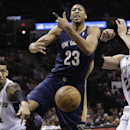 New Orleans Pelicans' Anthony Davis (23) loses the ball as San Antonio Spurs' Danny Green (4) and Tiago Splitter (22) defend during the first half of an NBA basketball game, Monday, Nov. 25, 2013, in San Antonio The Associated Press