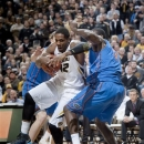 Missouri's Alex Oriakhi, left, fights his way past Florida's Patric Young, right, as he heads to the basket during the first half of an NCAA college basketball game Tuesday, Feb. 19, 2013, in Columbia, Mo. (AP Photo/L.G. Patterson)