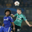 Chelsea's Willian, left, and Schalke's Julian Draxler go for a header during the Champions League group G soccer match between Chelsea and Schalke 04 at Stamford Bridge stadium in London, Wednesday, Sept. 17, 2014